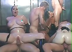 Black chick with big tits dilates vag in orgy sucking two large dicks