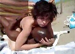 black haired slut fucks white man on the beach