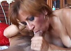 girl is standing on a sexy cougar getting banged