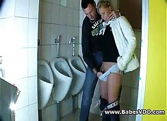 Blonde and mature on the couch in public bathroom